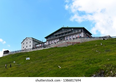St. Wolfgang, Austria - June 26, 2018: Amazing view on historic building (Haus Schafbergspitze) with hotel and restaurant on peak of Schafberg
