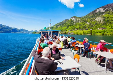 ST WOLFGANG, AUSTRIA - MAY 17, 2017: Boat trip on Wolfgangsee lake in Austria. Wolfgangsee is one of the best known lakes in the Salzkammergut resort region of Austria.