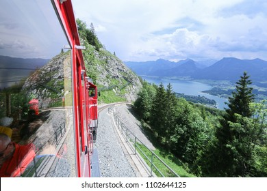 ST WOLFGANG, AUSTRIA: MAY 27, 2018 - The Schafberg railway train ferrying tourists from St Wolfgang to the peak of Schafberg mountain. The SchafbergBahn is the steepest cogwheel railway in Austria.