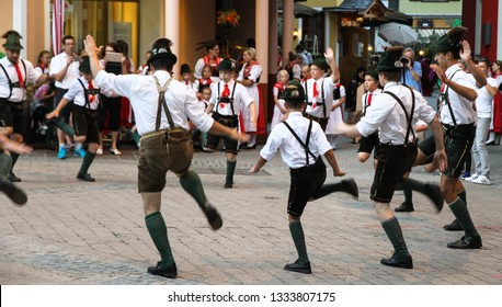 St. Wolfgang im Salzkammergut, Austria - Jul 13, 2017: Traditional Austrian folkloric dancing performing on streets with traditional clothes garments lederhosen and dirndls.