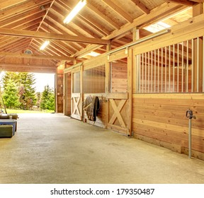 Stable barn with beam ceiling. View of the outside