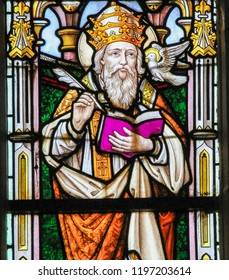 Stabroek, Belgium - June 27, 2015: Stained glass window depicting Saint Gregory the Great or Pope Gregory I, pope from 590 to 604, in the Church of Stabroek, Belgium.