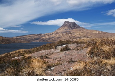 Stac Pollaidh above Loch Lugainn with stone slab in foreground