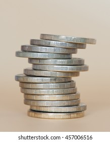 Stack of 10 rubles coins against golden background