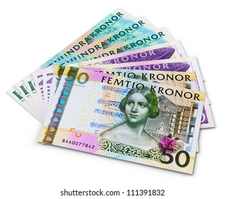 Stack of 100, 50 and 20 swedish krona banknotes isolated on white background