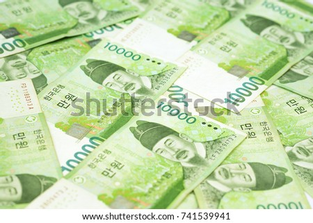 Stack of 10000 Korea won bills on table as money background. South Korean Republic Won is national currency of South Korea.