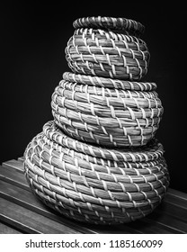 Stack of 3 bamboo baskets isolated on black