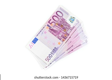 Stack of 500 Euro banknotes. European currency money banknotes isolated on white backdrop. Top view closeup. Salary, savings, european union economic crisis concept.