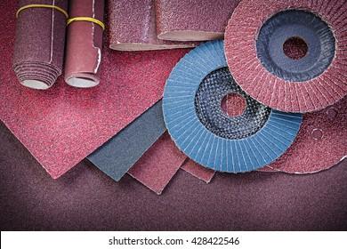 Stack of abrasive tools on polishing sheet.