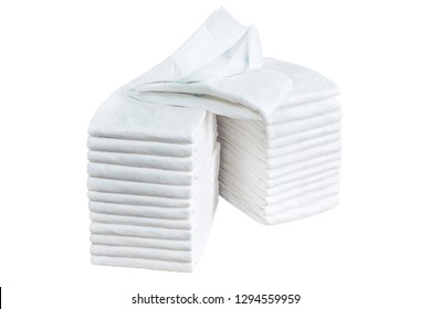 Stack of adult disposable diapers isolated on white background. Health care for elderly and bedridden people with urinary incontinence