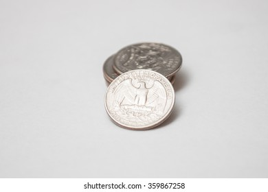 Stack of American Quarters with One Quarter Out Front