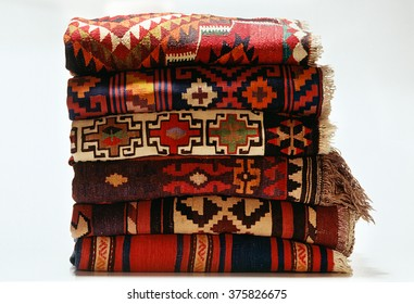 Stack of American South western rugs