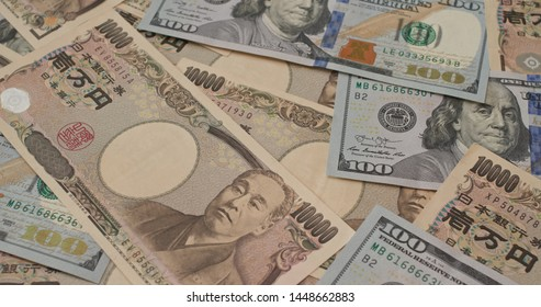 Stack of American USD and Japanese Yen