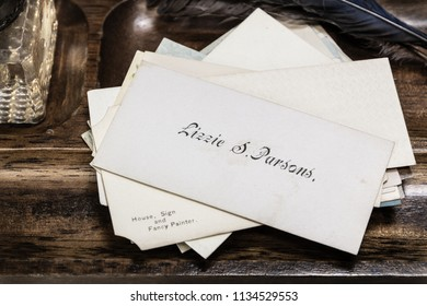 Stack of antique Victorian era calling cards. Lizzie S. Parsons on top of the pile.