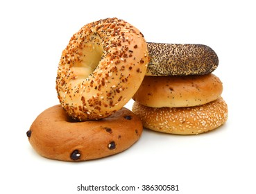 A stack of assorted bagels on white background