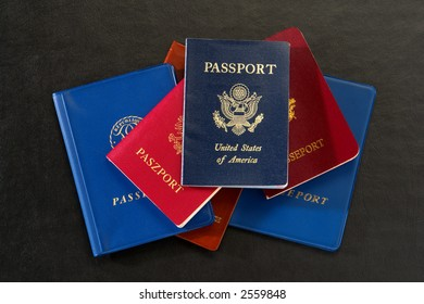 Stack of assorted countries passports with American citizenship proof and Europeans official identification documents