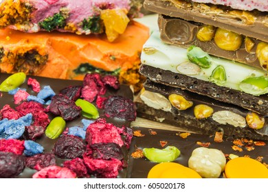 stack of  assortment delicious chocolate bars with different flavors