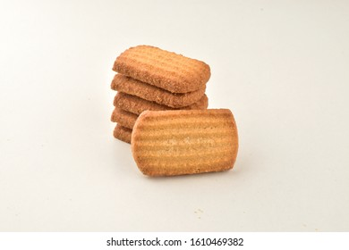 stack of baked biscuits isolated on white background