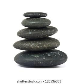 stack of balanced zen stones on white background