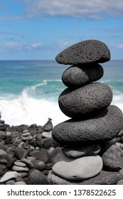 Stack of balancing stones on a Atlantic Ocean coastline, stone forest at Puerto de la Cruz, Tenerife, Canary Islands