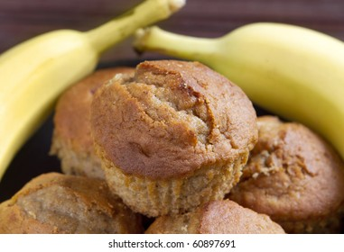 stack of banana muffins on a black plate closeup