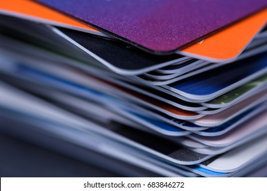 Stack of bank plastic credit and debit cards, thin dof