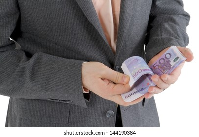 stack banknotes of 500 euro in male hands on a white background