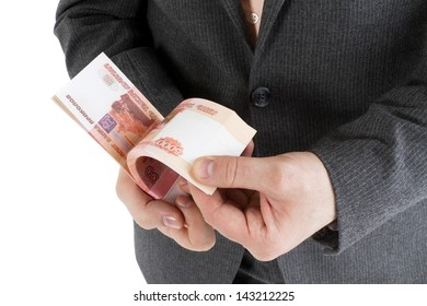 stack banknotes of 5000 rubles in male hands on a white background