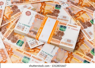 Stack of banknotes, many banknotes of five thousand Russian rubles as a background, packed stack of banknotes 5000 rubles, five hundred thousand