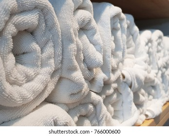 Stack of bath towels on light wooden at fitness Gym. Selective focus