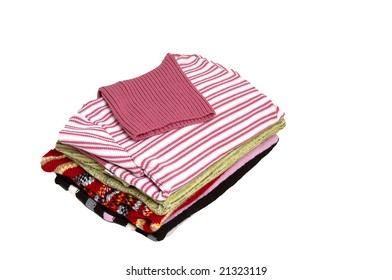 Stack beautiful sweaters isolated on a white.