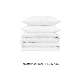 Stack of bedding on the white background. Two pillows and rolled duvet isolated on white. Bedding objects isolated against white background.