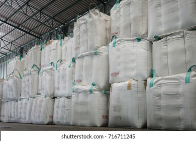 stack of big bag containing rice in warehouse, rice mill in thailand