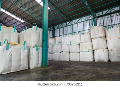 Stack of big bag or jumbo bag containing rice in warehouse, rice mill in thailand