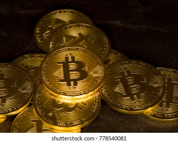 Stack of bit coins or bitcoin on slate background to illustrate blockchain and cyber currency