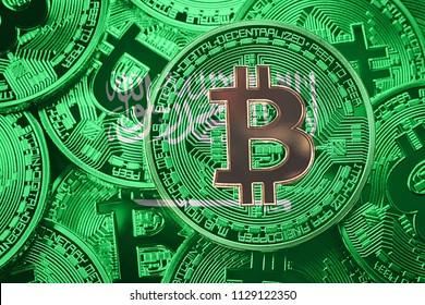 Stack of Bitcoin Saudi Arabia flag. Bitcoin cryptocurrencies concept. BTC background.