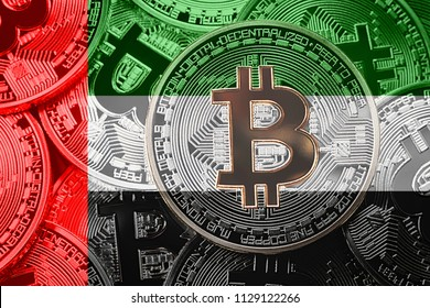 Stack of Bitcoin UAE flag. Bitcoin cryptocurrencies concept. BTC background.