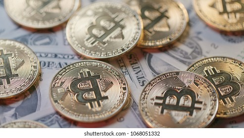 Stack of Bitcoin and USD - Shutterstock ID 1068051332