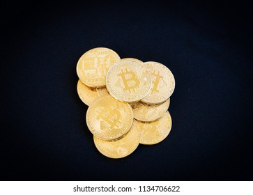 A stack of bitcoins on a black background.