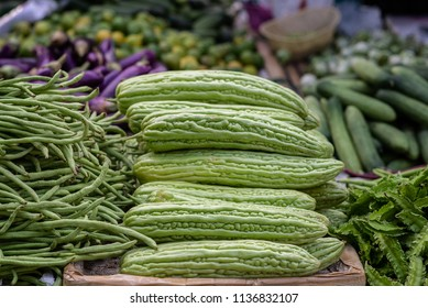 stack of bitter cucumber in vegetable market