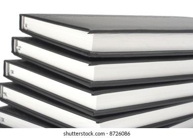 Stack of black books over white