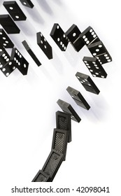 A stack of black dominoes falling on white background