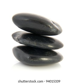 Stack black hotstones isolated over white background