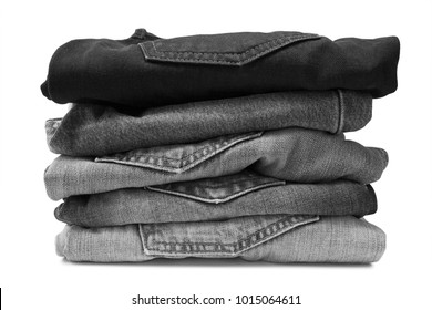Stack of black jeans isolated on white