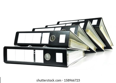 Stack of black ring binders with documents