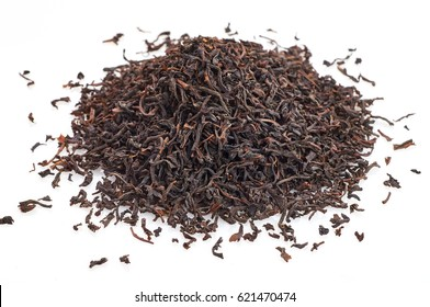 A stack of black tea on a white background