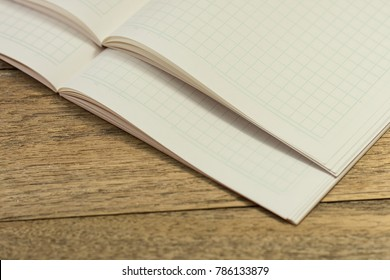 Stack blank notebook on wooden table for learning Japanese language writing words.