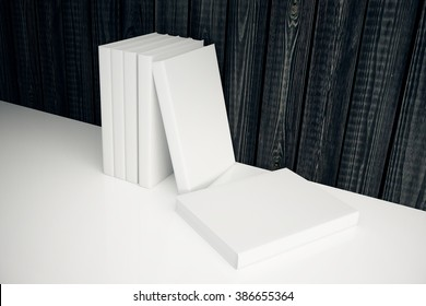 Stack of blank white books leaning on dark wooden wall. Mock up, 3D Render