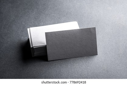 Stack of blank white business card on grey background. Blank name card.