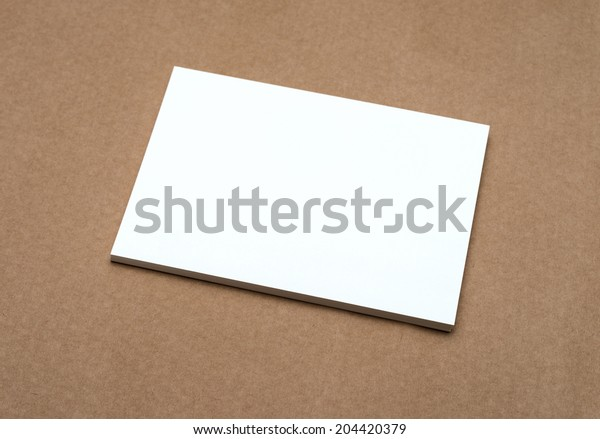 Stack of blank white business cards on crafts background